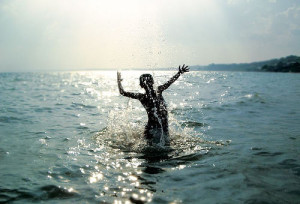 Boy Jumping out of the Ocean